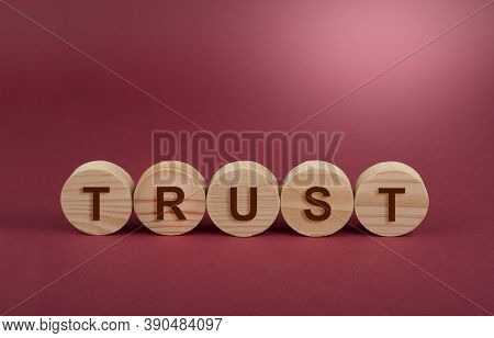 Trust Sign On A Wooden Circles On A Red