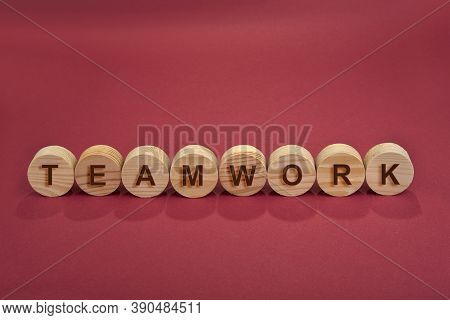 Teamwork Sign On A Wooden Circles On A Red