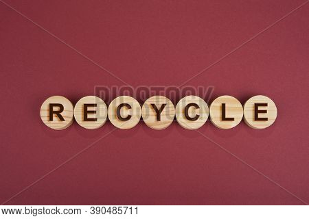 Recycle Sign On A Wooden Circles On A Red