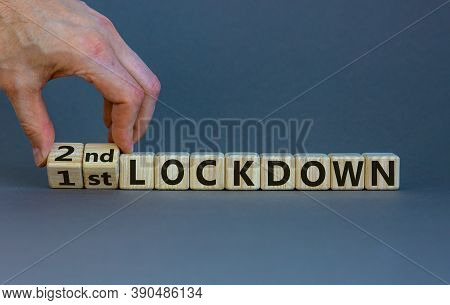Symbol For A Second Lockdown. Hand Turns Cubes And Changes The Expression '1st Lockdown' To '2nd Loc