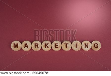 Marketing Sign On A Wooden Circles On A Red