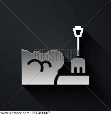 Silver Shovel In Snowdrift Icon Isolated On Black Background. Long Shadow Style. Vector