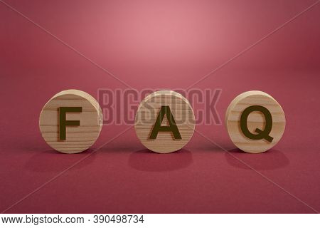 Blank Wooden Circles For Conceptual Sign On A Red. Frequently Ask Question