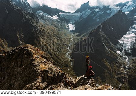 The Couple Travels Through The Caucasus Mountains. Couple In Love In The Caucasus Mountains. Man And