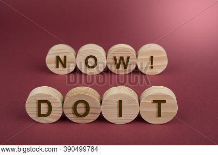 Blank Wooden Circles For Conceptual Sign On A Red. Do It Now