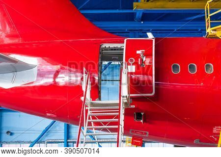 The Aircraft In The Hangar To Check Technical Systems Auxiliary Power Unit. Tail View And Rear Fusel