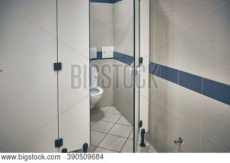 Open Door Of Public Toilet Stall. Toilet Bowl Inside Toilet Stall