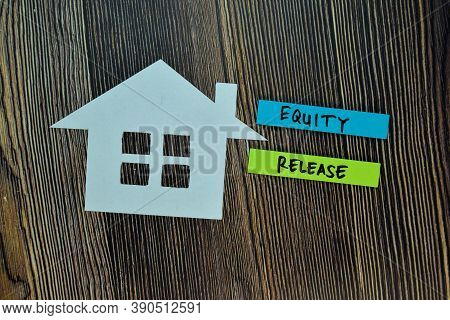 Equity Release Write On Sticky Note And House Made From Paper Isolated On Office Desk. Retirement Co