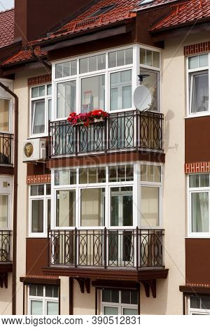 Glazed Balcony In A Modern Apartment Building. Balcony With A Metal Wrought-iron Lattice