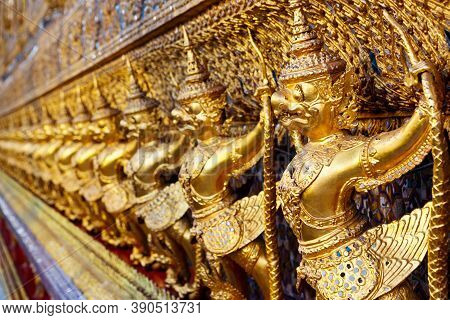 Golden Garuda And Naga Statue, Decoration On A Wall Of The Emerald Buddha Temple, Wat Phra Kaew, Gra