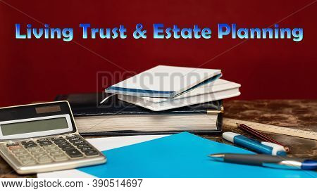 Living Trust And Estate Planning. Blue Letters On A Red Background. Financial Instruments Concept.