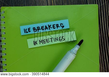 Ice Breakers In Meetings Write On Sticky Notes Isolated On Wooden Table.