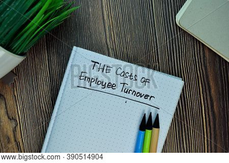 The Costs Of Employee Turnover Write On A Book Isolated On Wooden Table.