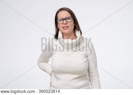 Loin Spasm. Mature Woman In Glasses With Hurt Backbone.
