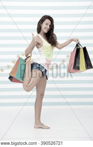 Happy Girl Show Thumb Up For Shopping Benefit. Happy Girl With Shopping Bags. Sale Benefit And Speci