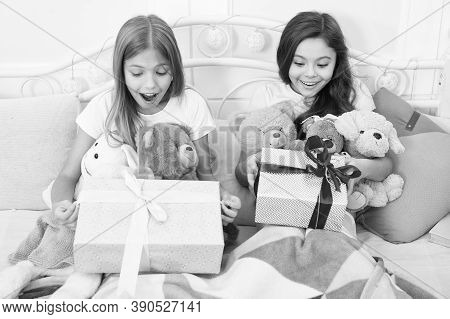 Surprise Inside. Surprised Children In Morning. Little Girls Open Present Boxes In Bed. Gift Surpris
