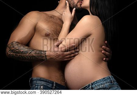 A Tender Kiss. Sensual Couple In Love. Family Couple Expacting A Baby. Married Couple Of Pregnant Yo