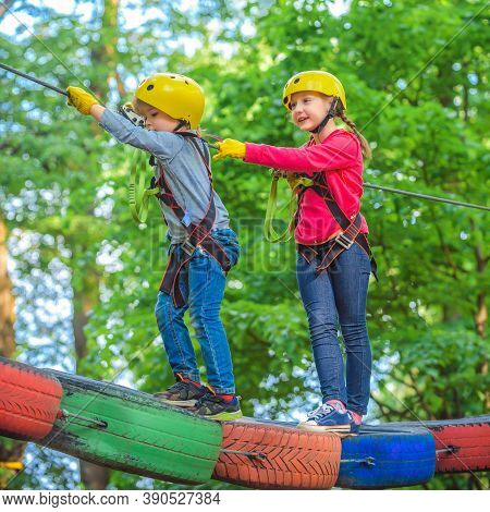 Hike And Kids Concept. Child Boy Having Fun At Adventure Park. Climber Child. Climber Child On Train