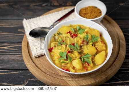 Aloo Gobi Side Dish. Traditional Vegetarian Indian Curry Dish With Potatoes, Cauliflower, Spinach Wi