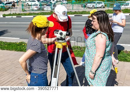 Samara, Russia - June 12, 2019: Students Conduct Classes On Geodetic Works With Geodetic Optical Lev
