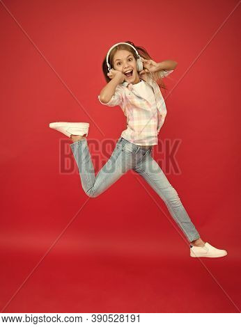 Jumping Mid Air. Happy Small Girl Dancing. Cute Child Enjoying Happy Dance Music. Music Is Happiness