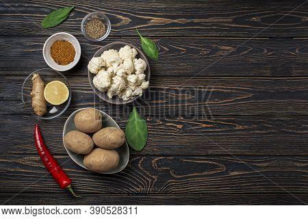 Aloo Gobi Ingredient Set. Traditional Vegetarian Indian Curry Dish With Potatoes, Cauliflower, . Cop