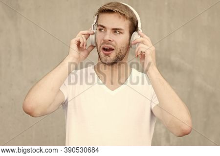What A Pure Sound In Phonics. Handsome Guy Listen To Sound Track. Surprised Man Enjoy Music In Earph