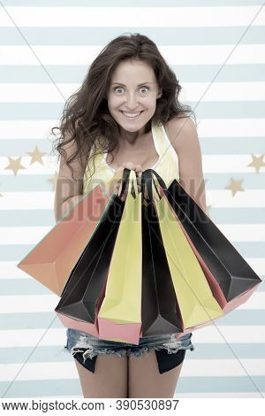 Happy Shopper Girl With Shopping Bags. Happy Shopper After Day Shopping. Girl Hold Colorful Sale Pap