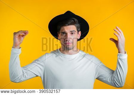 Handsome Man Showing Bla-bla-bla Gesture With Hands Isolated On Yellow Background. Empty Promises, B