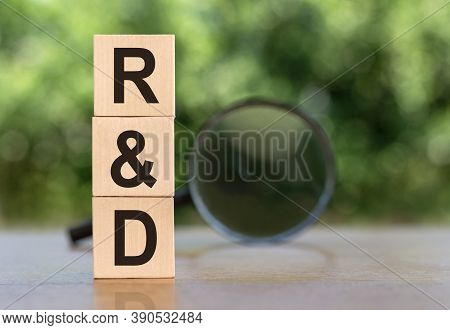 R And D Word Written On Wooden Blocks. Sales, Business Concept