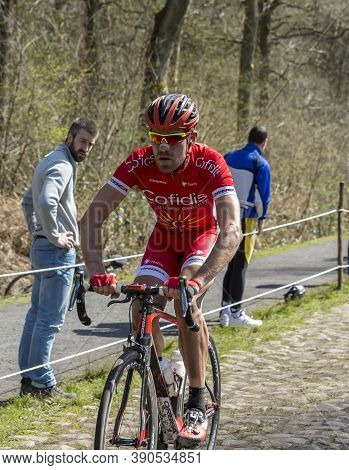 Wallers, France - April 12,2015: The French Cyclist, Cyril Lemoine Of Cofidis Team Riding On A Cobbl