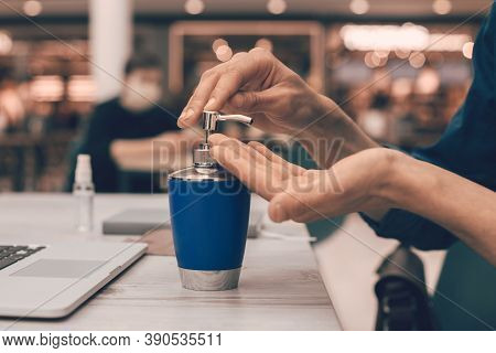 Close Up. Man Applying A Decontaminating Gel To His Hands.