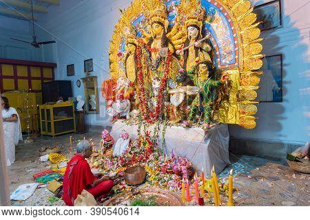 Kolkata, West Bengal, India - 6th October 2019 : Hindu Purohit Uttering Holy Sanskrit Shlokas For Pu