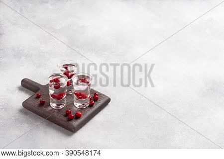 Stacks Of Vodka And Cranberries On A Wooden Stand And Background. Copy Of The Space. Bar Alcoholic B
