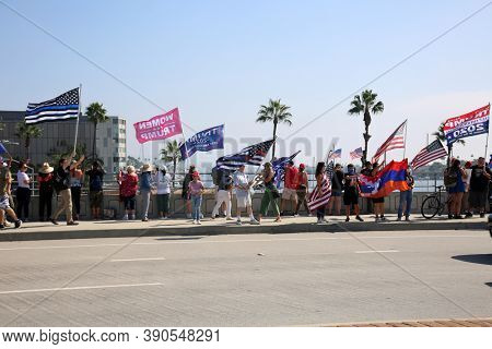 Newport Beach, California / USA - October 18.2020: Lido Isle Newport Beach, Supporters and Voters Cheer, Wave Flags, and Enjoy watching for President Donald J. Trump to arrive for a private Fundraiser