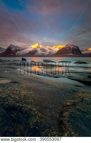 Unique winter sea landscape with dramatic sky and mountains. The beauty of the Northern nature. Norway, island of Senja. Hight quality