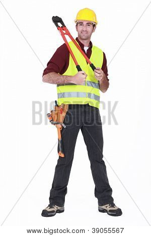 Man wearing a hard hat and holding large clippers