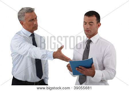 Angry boss displaying his displeasure to his employee
