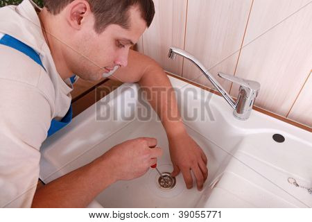 Plumber repairing canalisation
