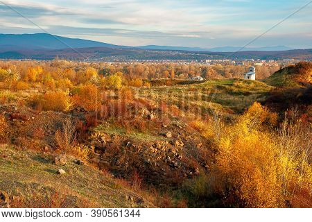 Rural Valley At Sunset. Beautiful Autumn Landscape In Mountains. Village In The Distant Valley. Clou