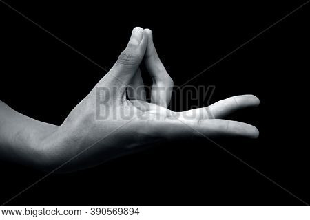 Shot Of A Male Hand Demonstrating Prana Mudra Isolated On Black Background.