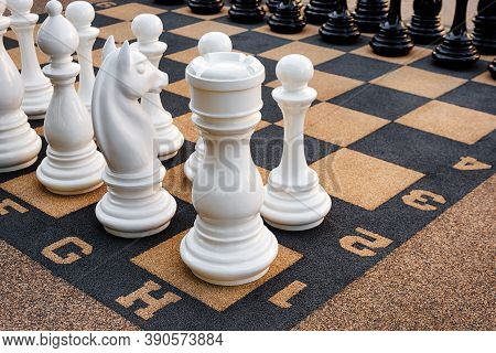 Outdoor Chess Board With Big Plastic Pieces. Giant Size Chess In Public Area Zone. Close Up Big Piec