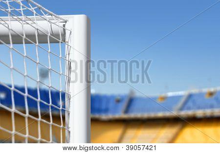 white goalkeeper gate on big empty stadium