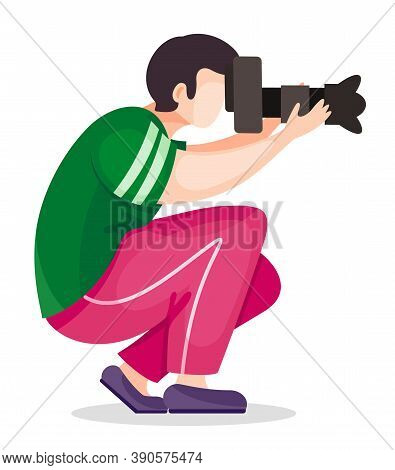 Photographer Or Paparazzi Squatted Down To Take The Best Photo From Right Angle Using High Resolutio