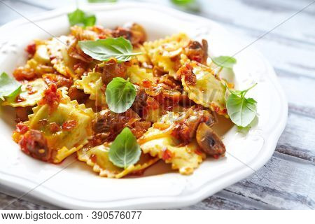 Ravioli With Mushrooms And Fresh Basil. Bright Wooden Background. Close Up.