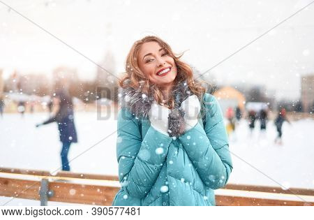 Beautiful Lovely Middle-aged Girl Curly Hair Warm Winter Jackets White Glove Stands Ice Rink Backgro