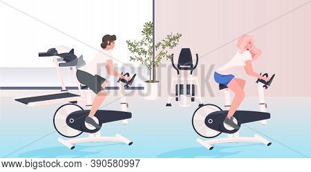 Women Working Out On Stationary Bike Fitness Cardio Training Workout Healthy Lifestyle Concept Moder