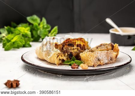 Pear Spicy Strudel, Sweet Strudel With Pear With Cinnamon, Raisin, Powdered Sugar And Mint. Austrian