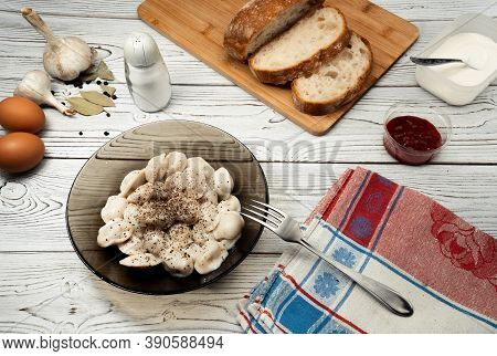 Traditional Russian Pelmeni, Ravioli, Dumplings With Meat On Wood Background. Design And Food Stylin