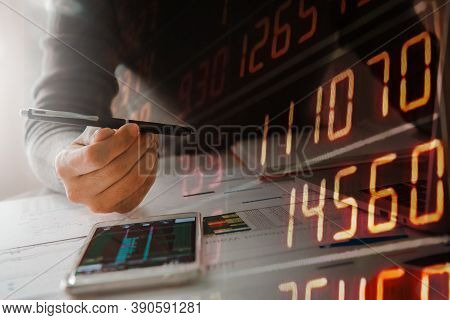 Businesswoman  Holding Pen, Business Documents, Reports, Graphs And Charts Of Financial Statements A
